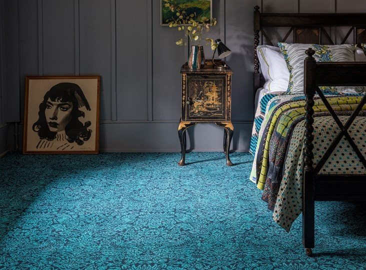 Is wool or synthetic carpet better?
